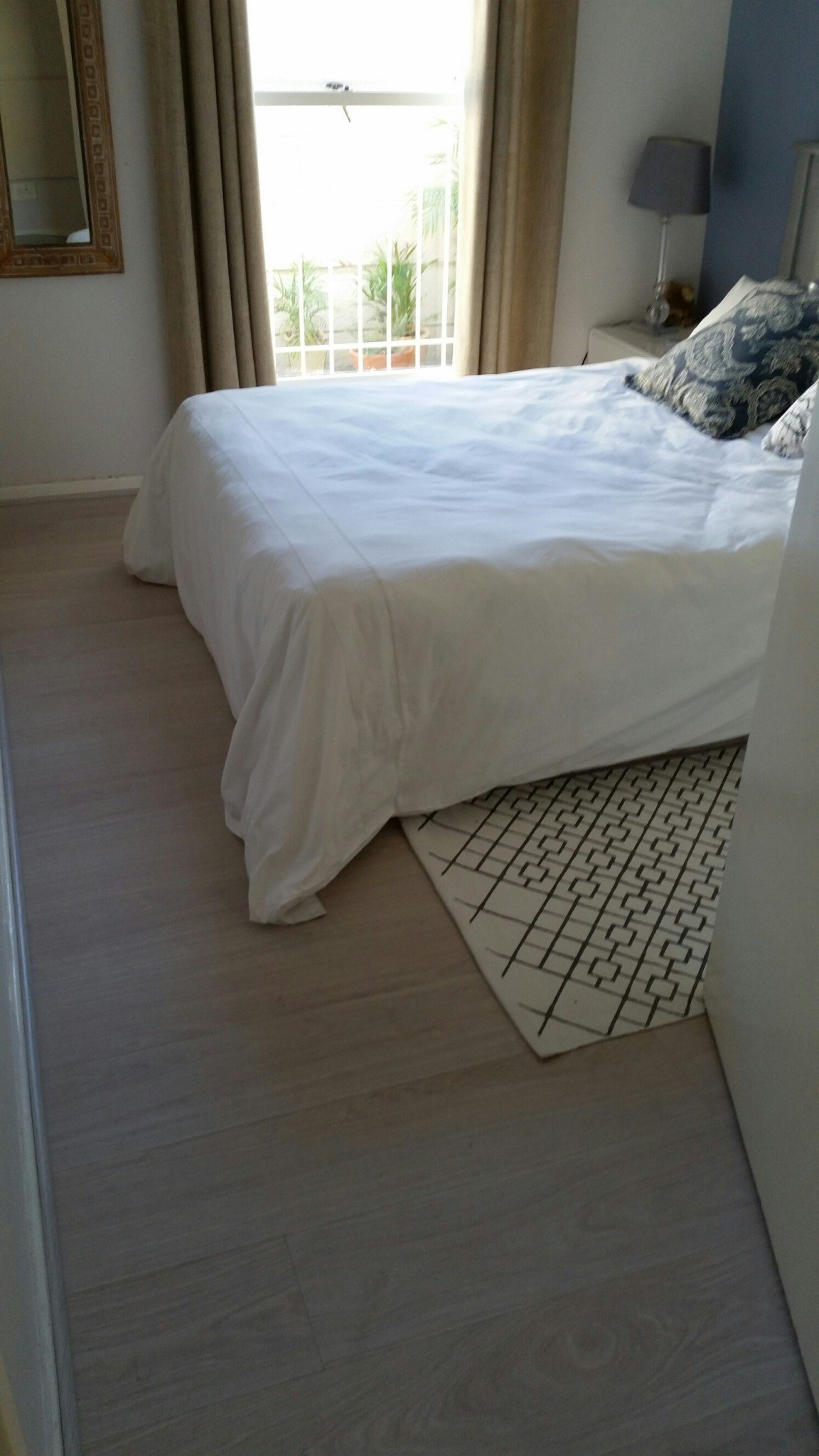 Exquisite Kronotex Waveless Oak White 8mm Laminate Boards. Recent installation in Constantia.