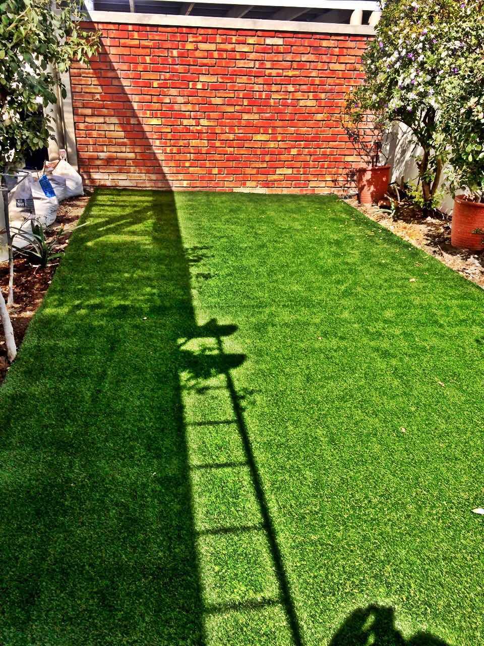 atrificial grass installation surface preperation picture tlc flooring cape town 1
