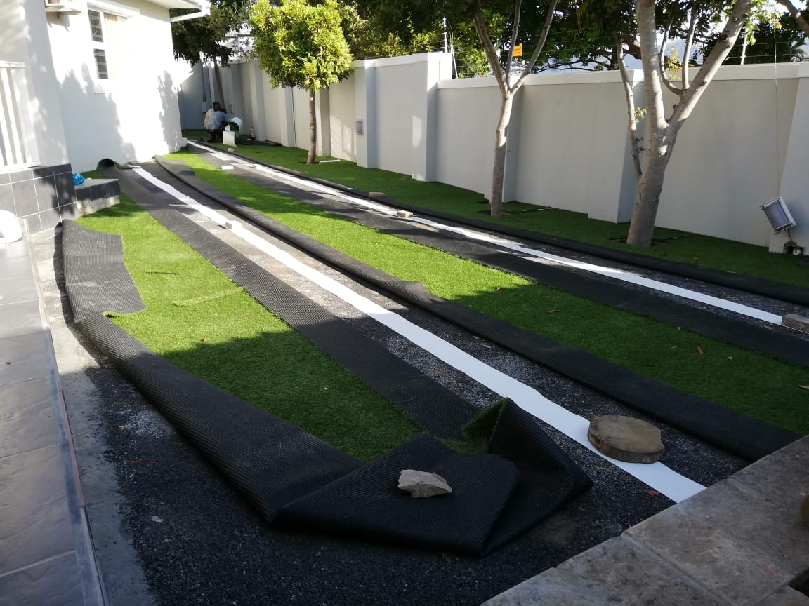 Artificial grass installation during photos